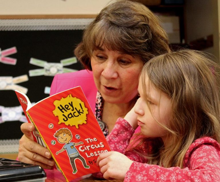 Kathy Danek reading with a student