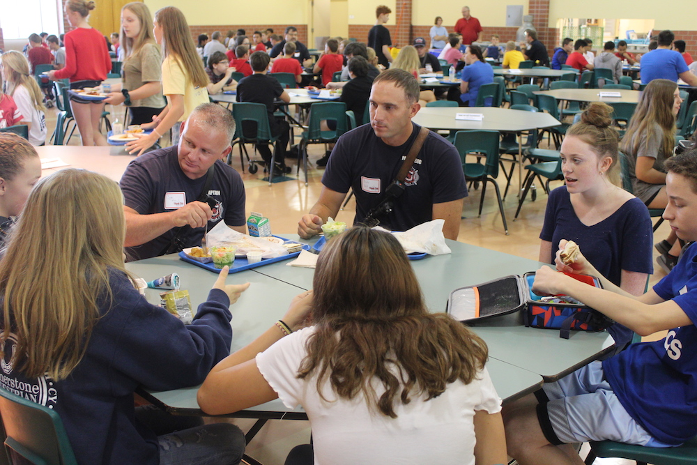 Photo of first responders enjoying lunch with Lux students