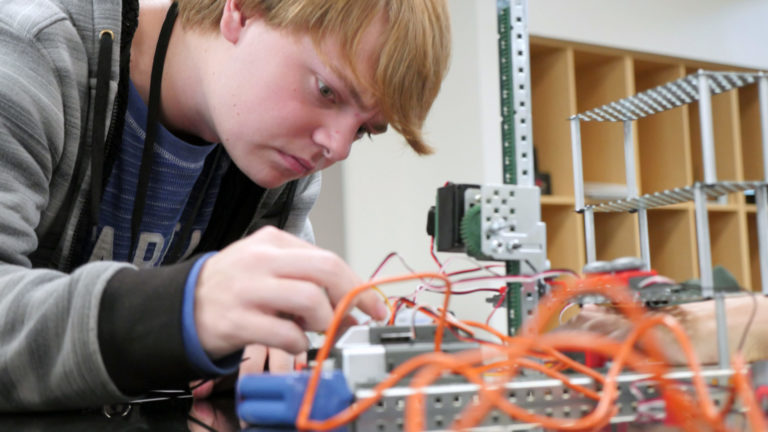 Photo of a student working on an engineering project