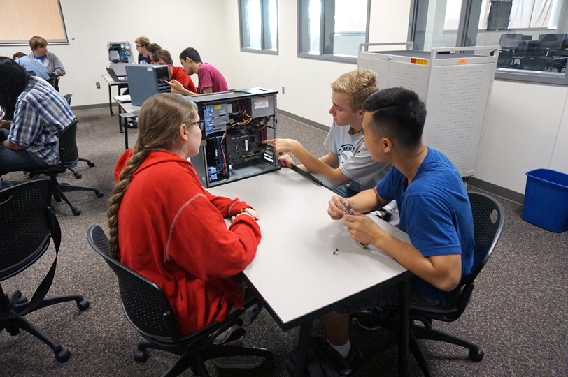 Photo of students working on a computer workstation