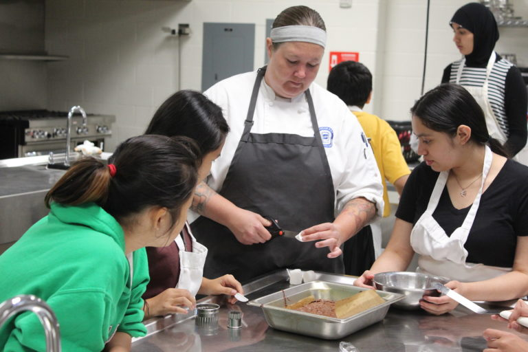 Students learning about cooking
